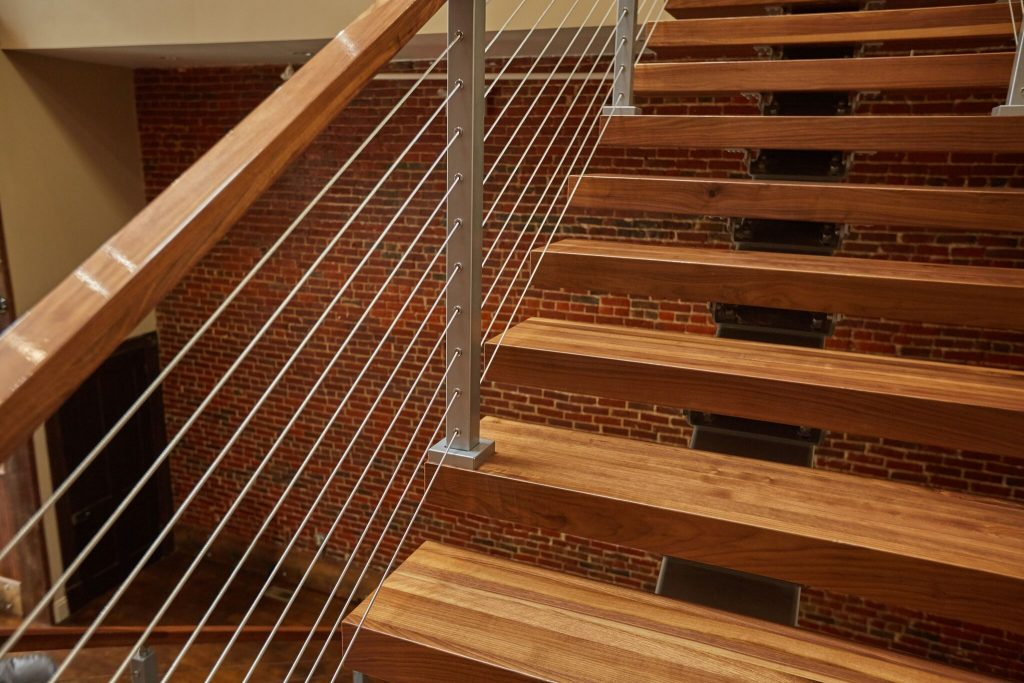Cable railing on floating stairs closeup