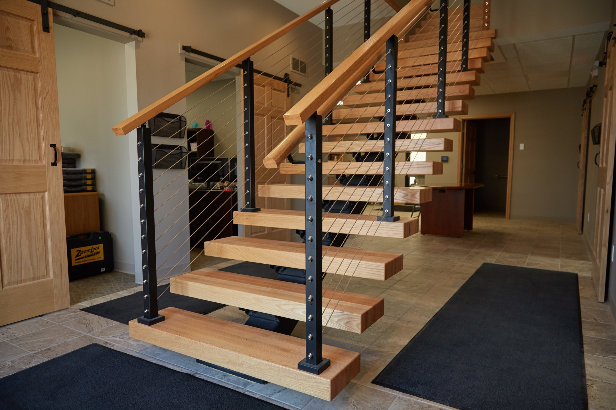 Floating Stairs With Clear Coated Treads And Graspable Handrail