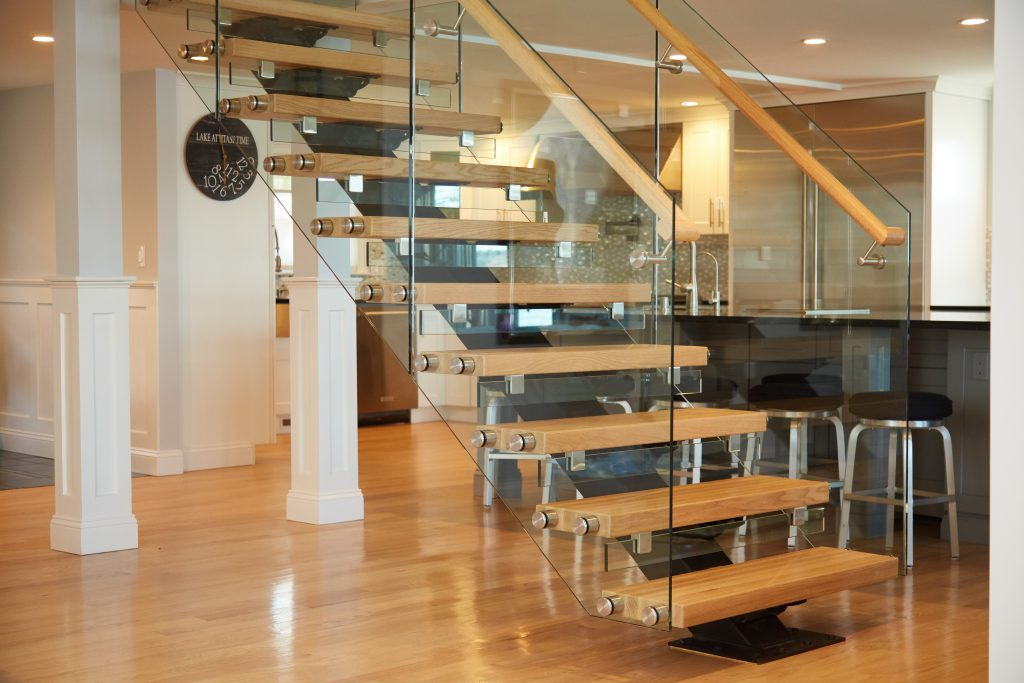 Glass railing standoff pins on floating stairs
